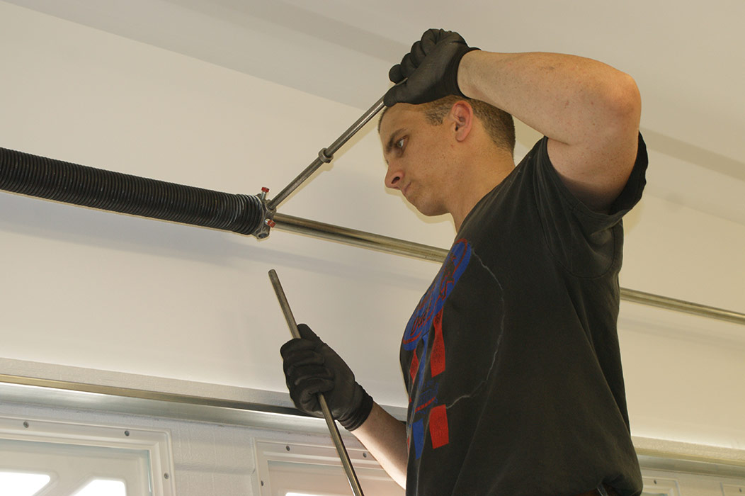 Aaron Junior Installing Garage Door Spring