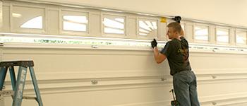 Photo Installing Garage Door Section With Windows