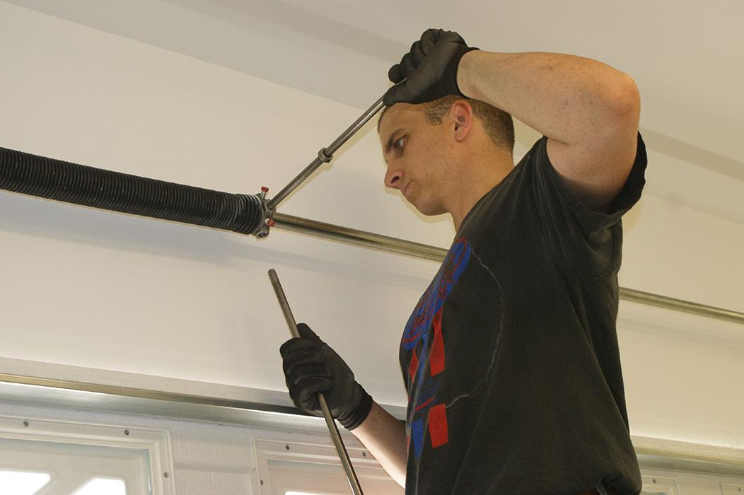 Aaron Junior Installing Garage Door Spring
