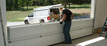 Photo Installation Of Garage Door Section