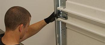 Photo Garage Door Installation Checking Track Alignment